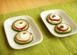 Cucumber appetizer with cheese and radish