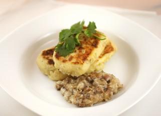 Kartofelniki with Meat in Mushroom Sauce