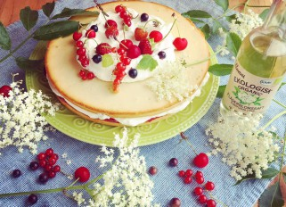 Cake with strawberry/ red currant jam and elderflower cream