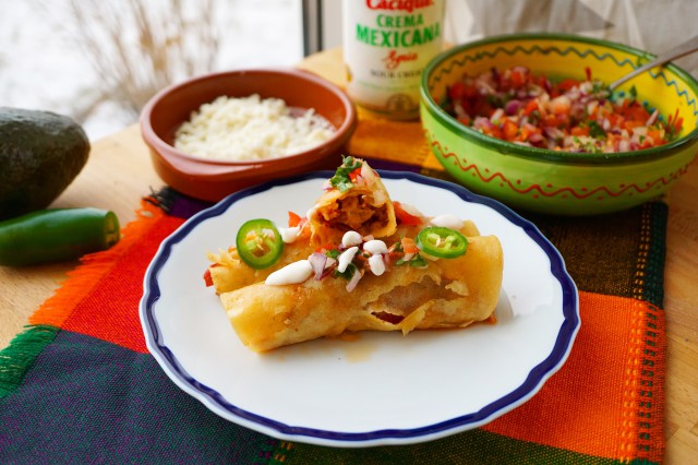 Slow cooker pork tinga ( pulled pork) flautas with chorizo, tomato chipotle