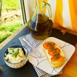 Whipped feta cheese with tomatoes and basil on toast