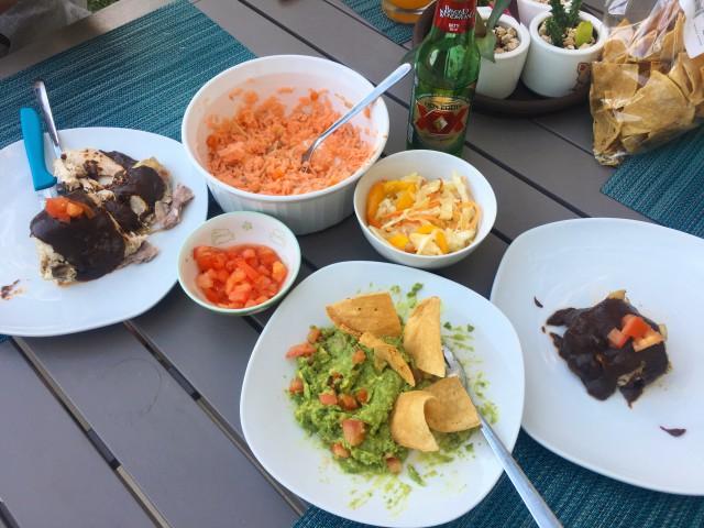 Chicken mole, Spanish rice rojo, pickled cabbage and guacamole