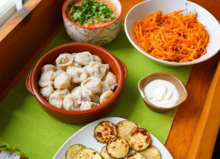 Pelmeni, Korean carrots, fried zucchini and salsa
