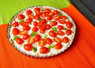 Mozzarella feta tart with cherry tomatoes and pesto