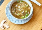 Asian-style duck soup with rice vermicelli and mushrooms