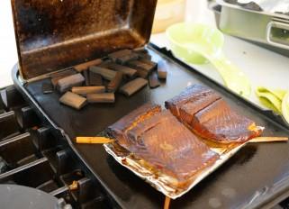 Smoked salmon on a gas stove-top